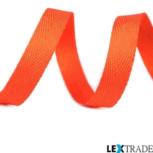 Кусок киперной  текстильной ленты красного цвета